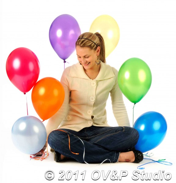 studio photography of model with balloons