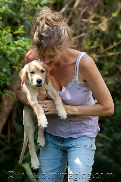 Naomi Estment with Golden Retriever puppy