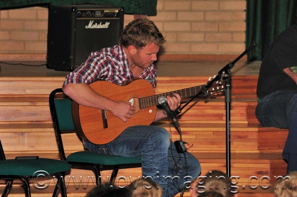Jason Hartman singing at Beaulieu Prep